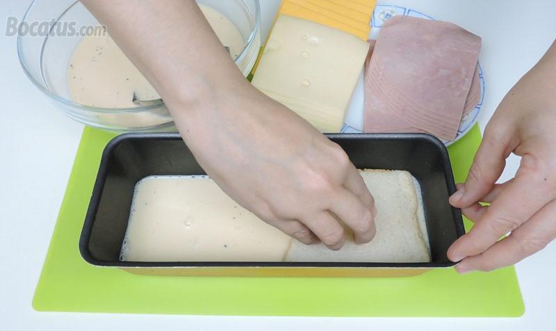 Poniendo la primera capa de pan de molde